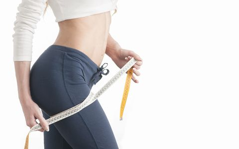 Woman body care and measure on thighs.Perfect body, concept